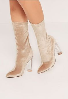 go for gold with these crushed heeled sock boots.