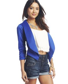 """<p>Make a casual look dressy or a refined outfit even better with this lightweight knit blazer featuring a solid color, ruching at each 3/4-sleeve cuff and open front with a slightly longer and pointed hem at each front side. It also includes mock pockets at each lower side on the front and simple lapel design. Unlined.</p>    <p>Model is 5'9"""" and wears a size small.</p>    <ul>  <li>83% Polyester / 12% Rayon / 5% Nylon</li>  <li>Hand Wash</li>  <li>USA</li>  </ul>"""