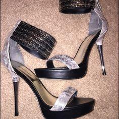 Bebe heels Bebe metallic silver and black heels never worn. bebe Shoes Heels