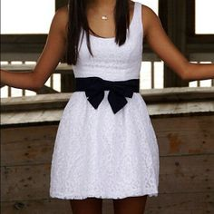 pretty white dress with a black bow cute for spring or for school pictures