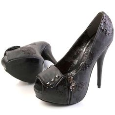 Iron Fist RUFF RIDER Product Information    Black platform pumps with sparkling black skulls, studded accents, and skull zipper pull. These have an open toe, high heel, and concealed platform.
