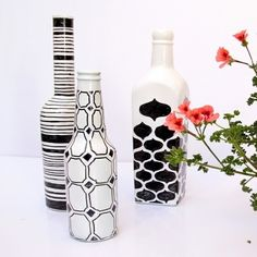 Paint empty bottles white and draw designs on them with Sharpie to make modern, graphic vases.