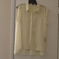 Sheer bottom down top! Yellow button down top with studs on collar and sleeves. Sleeves are made like muscle sleeves, so it droops down to the bra line. Material is a see through polyester. Forever 21 Tops Button Down Shirts