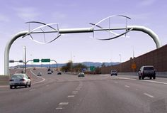 I love this kind of innovation! Wind turbines on a freeway. One of the arguments I hear against wind turbines is that they're loud, well, so is a freeway.