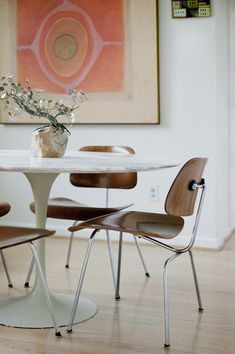 white walls, contemporary art, dining table