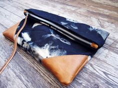 denim + leather clutch