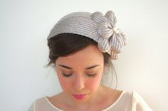 This vintage-styled fascinator is handmade and molded on a wooden dolly head.    Perfect for a wedding with a cocktail dress or a vintage