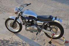 """At a quick glance, this classic-styled Triumph Scrambler looks like something that may have rolled straight off a factory assembly line 40 years ago. Don't let the look fool you; this retro is a thoroughly modern motorcycle with plenty of """"go"""" to match the """"show."""" Covered by BikeEXIF."""