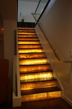Contemporary Staircase -this would be cool going to the basement, but how do you change the bulbs??