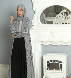 Comfortable and versatile Black and White Striped Kimono is designed to be used as a light cover up over any outfit. Made from soft cotton fabric.