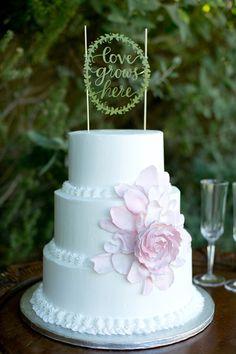 """Love grows here"" cake topper, photo by Amber Lynn Photography http://ruffledblog.com/love-grows-wedding-inspiration #weddingcake #cakes"