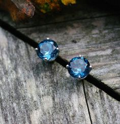 Hey, I found this really awesome Etsy listing at https://www.etsy.com/listing/83274196/aaa-london-blue-topaz-stud-earrings-6mm
