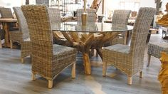 WOW! Our fantastic Teak root 8 seater dining set features our stunning 180cm large round root table with tempered safety glass top. A unique piece of furniture, timeless and makes a statement in any home.   Accompanying this table are 8 of our stylish natural kubu dining chairs. The table is a standard dining height at 75cm. The natural woven Kubu takes on a grey hue and is a very strong material, so you can have both strong and beautiful furniture.
