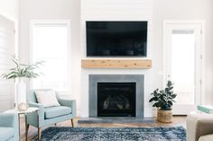 Love this fireplace! The combination of natural wood, shiplap and concrete surround make for the perfect modern farm house feel. See the full modern farmhouse tour on DesignLovesDetail.com