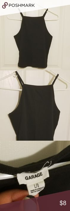 Black Crop Top A simple black cropped halter top. Goes great with any item of clothing! Gently used. Garage Tops Crop Tops