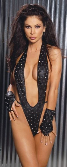 Elegant Moments Lingerie Leather Teddy L2175 Studded black leather teddy with around the neck strap, deep scooped front which goes down to belly button and strappy sides with thong back for added sexiness. The open back creates a provocative loo http://www.MightGet.com/january-2017-12/elegant-moments-lingerie-leather-teddy-l2175.asp