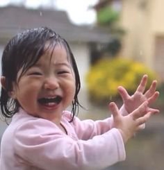Little Girl Laughing and Smiling in the Rain.❤️                                                                                                                                                      More