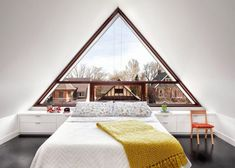 Victorian-Era Home Is Completely Transformed with a Contemporary Triangular Window - My Modern Met