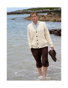 Irish Fisherman style cardigan knitted in pure wool using traditional Aran patterns. Irish Traditions, Knit Cardigan, Knitwear, Men Sweater, V Neck, Irish Sweaters, Pure Products, Blazer, Traditional