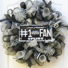 Go Spurs Go! Spurs fever is starting to heat up, and this San Antonio Spurs themed deco mesh wreath is a winning way to show your team spirit!