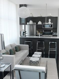 love this kitchen and living room combo but I think it needs a bit more color.