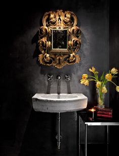 The bronze mirror complete the picture and makes the black wall in a small space work.