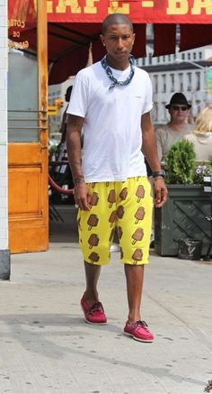 Pharrell Williams a pair of BBC Ice Cream shorts, with a white tee-shirt and a pair of Band of Outsiders for Sperry Top-Sider Deck Shoes in the red colorway.
