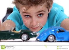 Little boy playing with cars portrait