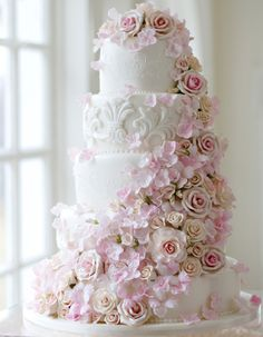 www.facebook.com/cakecoachonline - Spectactular cascade of flowers, and a lot of detail on each tier..