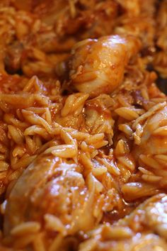 Youvetsi. Chicken cooked with orzo pasta in a tomato sauce seasoned with cinnamon and bay leaves.