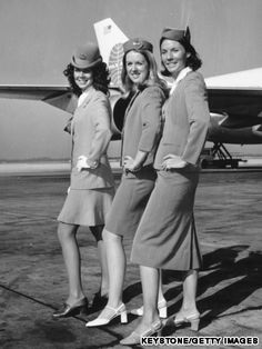 From right to left: Pan Am flight attendant uniforms from the 1950s to the 1970s. Increased sensitivity toward fashion resulted in higher hemlines.