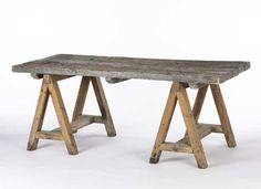 Rustic wood dining table with sawhorse legs. Wood varies in color and texture. W: in × D: 34 in × H: in Rustic Table, Rustic Wood, Barn Wood, A Table, Door Tables, Farm Tables, Kitchen Tables, Table Saw, Dining Tables