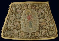 Gold-thread embroidered cuff with a depiction of the Virgin surrounded by vegetation and flowers, part of an Annunciation scene. 19th c. H. 0.19 m. (ΓΕ 9404) image and text copyright Benaki Museum