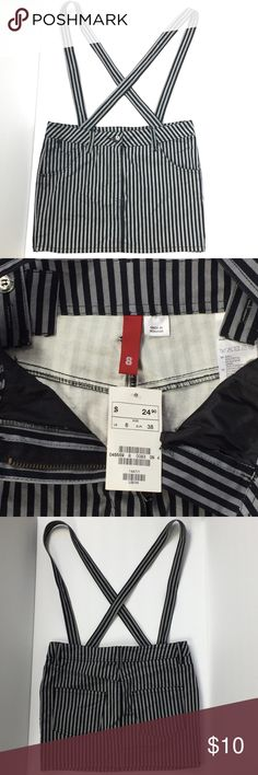 H&M Women's Skirt w/Suspenders Black /Gray Stripes Brand New item with tags. Skirt has two front and two pack pockets. Mini skirt length is about 12.5 inches. Suspender straps can be work straight, crossed, or can be removed from skirt depending on your preference. H&M Skirts Mini