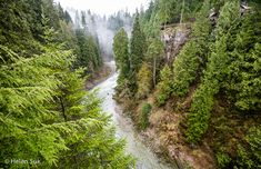 view of the river from the suspension bridge at capilano suspension bridge park