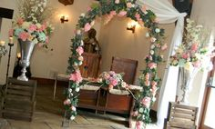 We dressed the wedding ceremony with a luxurious bridal arch, silver urns on crates and a registrars table all in beautiful shades of pinks, ivorys and mint green, a beautiful combination. www.am-flowers.co.uk