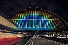 daan roosegaarde unravels a rainbow of light at amsterdam central station