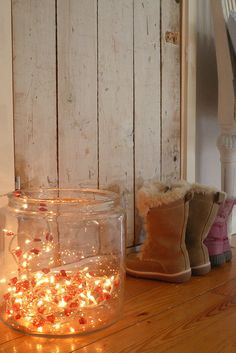 Lights. so simple. would be adorable grouped with pumpkins and hay on my porch.