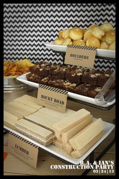 Construction party snacks: Rolls (or maybe cake balls or mini cupcakes without a wrapper): boulders Brownies with walnuts: Rocky road Vanilla wafer cookies: lumber