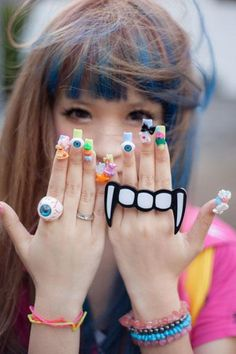 Harajuku Fashion. The nails and the four-finger ring are fantastic!
