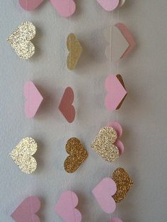 Hang our Pink and Gold Lux Heart Paper Garland for some sparkle! Our garland has soft pink and gold tones with just the right amount of glitz.