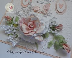 This rose and baby's breath created with Susan's Garden dies. I posted a tutorial for creating the baby's breath on my blog: http://selmasstampingcorner.blogspot.com/2015/07/susans-garden-rose-with-babys-breath.html