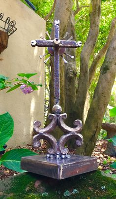"""Open to All"", cross made from industrial scrap iron, old New Orleans gate fragment, and vintage nails. By Birmingham metal artist Catherine Partain Shamblin"