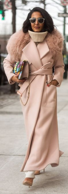 Nausheen Shah in a long blush pink coat with a furry neck: NYFW street style