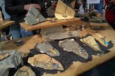 Slate, glass and gravel, It would make a better display in a store than one to travel with but it's beautiful.