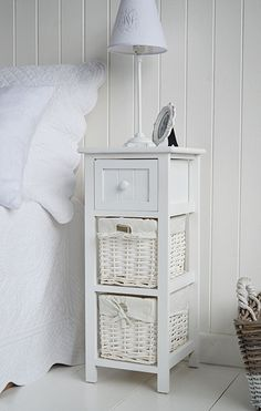 White bedside table in Bar harbor with baskets and drawer