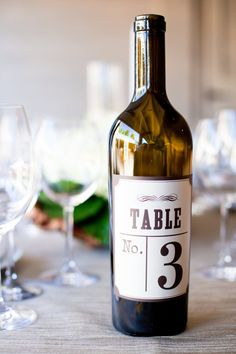 I like this Table Number Idea - you could DIY your own labels and a great excuse to quaff several bottles of wine in preparation for the wedding!