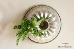 Kitschy Christmas wreath made from jello molds and faux vintage corsages