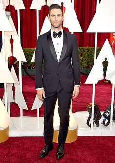 """The Oscar performer (he sang """"Lost Stars"""" from Begin Again) slipped into an Armani tuxedo for the red carpet."""