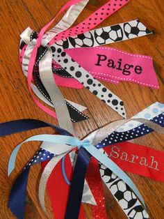 Custom Hair Bows Idea - Another use for my new embroidery machine. Also, a great way to make it easier for everyone to tell the girls apart.